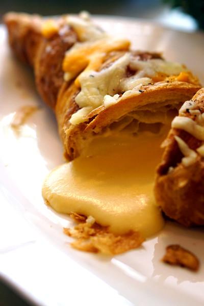 Antoinette - Finale of La Croissanterie Series - Quatre Fromages (4 Cheeses) Croissant Closeup